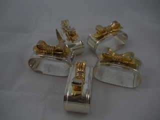 Slverplate Oval Napkin Rings With Gold Color Bows On Top