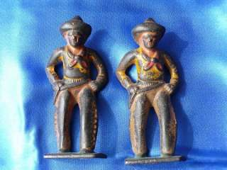 PRE WW2 SEVEN CAST GREY IRON FIGURINES 2 COWBOYS 2 INDIANS 3 PIRATES