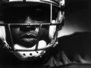 Close up of an American Football Player Wearing a Helmet Photographic