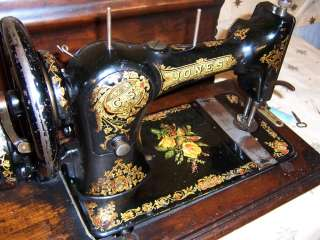 1890s Jones Hand Crank Sewing Machine Family CS Yellow Rose bed